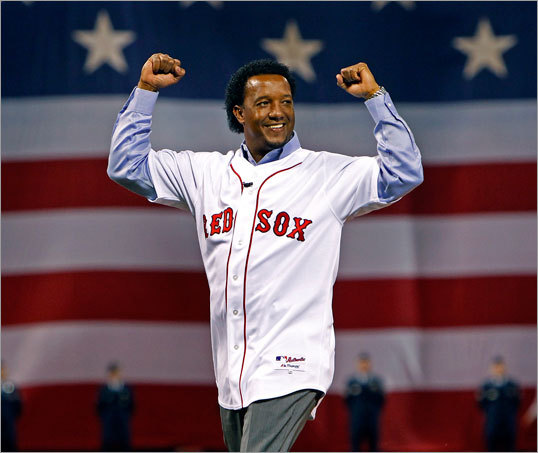 Pedro Martinez threw out the first pitch Sunday night before the Red Sox and Yankees opened the 2010 MLB season at Fenway Park.