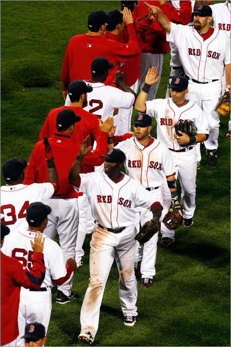 The Red Sox celebrated after defeating the Yankees 9-7 in the season opener Sunday night at Fenway Park.