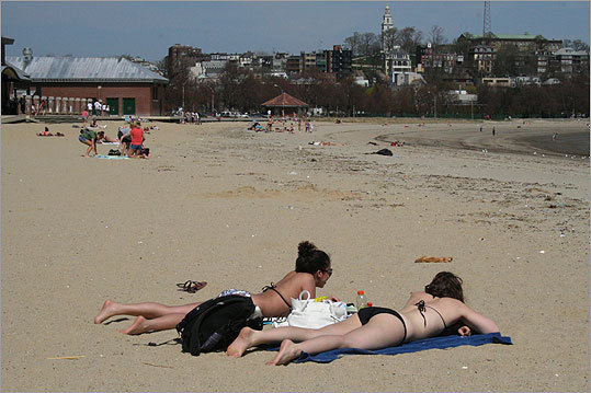 With temperatures reaching a record high of 89 degrees Wednesday, people all over Boston couldn't help but hit the beach or just get outside and enjoy the unusually hot weather. A view of Carson Beach.