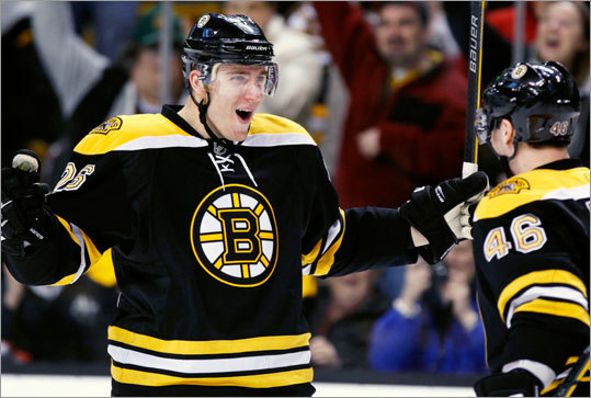 Boston Bruins' Blake Wheeler, left, celebrates his goal with David Krejc during the second period against the Carolina Hurricanes Saturday.