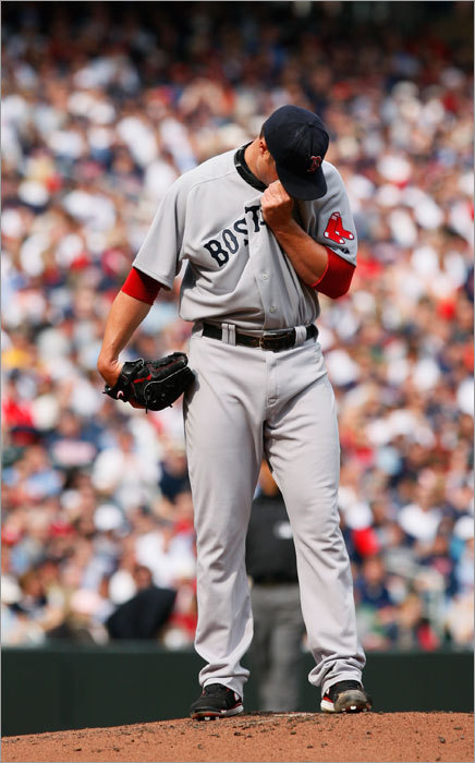 Lester wiped his face after walking Minnesota Twins' Delmon Young to load the bases during the first inning.