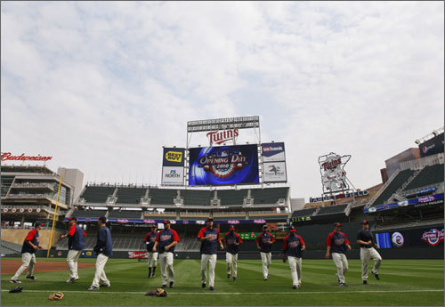 Members of the Minnesota Twins warmed up during batting practice prior to their home opener against the Red Sox.