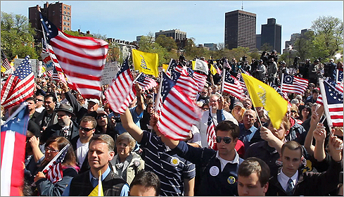 A large crowd waved flags in front of the stage.