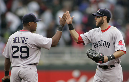 Red Sox left fielder Jeremy Hermida (right) is congratulated by Adrian Beltre after the Sox defeated the Minnesota Twins 6-3 on Wednesday in Minneapolis.