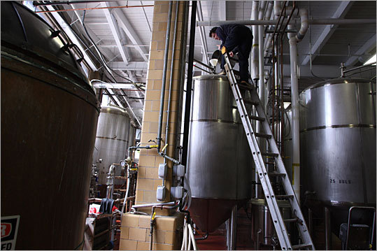 Andrew Lamont works on a batch of beer in the brewery. Boston Beer is publicly-traded company and turned a profit of $31.1 million on revenue of $440 million last year, while shipping just under two million barrels of beer.