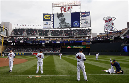 Members of the Minnesota Twins players warmed up at Target Field on Thursday afternoon. Every player around the league will wear number 42 in honor of Jackie Robinson Day today.