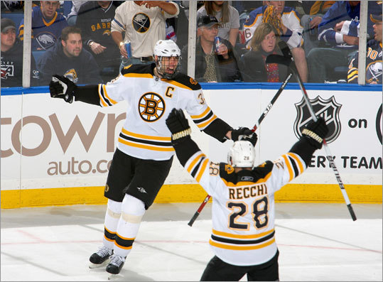 Bruins Zdeno Chara and Mark Recchi celebrated Chara's goal in the second period against the Buffalo Sabres in Game 2 of the Eastern Conference quarterfinals Saturday at HSBC Arena in Buffalo, New York.