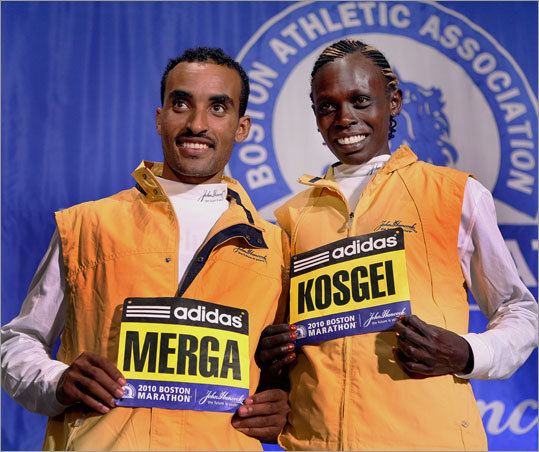 Last year marathon winners Deriba Merga and Salina Kosgei receive their bib numbers at the Fairmont Copley Plaza, Saturday morning.