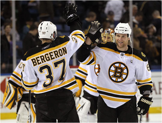Boston Bruins center Patrice Bergeron (37) and defenseman Dennis Wideman (6) celebrated their team's 5-3 win over the Sabres in Buffalo, New York. The win tied the series between the two teams 1-1.