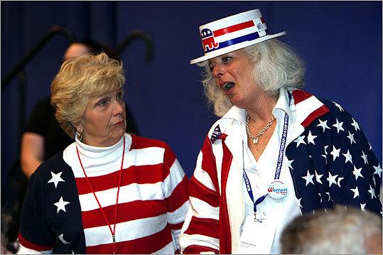 Pat Barrett, left, and Debbie Holmwood, both of Norwood, kept the patriotic theme going.
