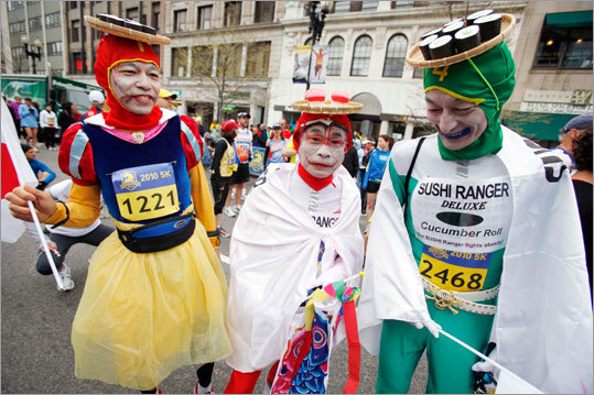Tetsutomo IIzuka (left), Yasuo Sakai (center) and Mayumi Okunishi, all of Japan, dressed in a sushi theme for the 5K.