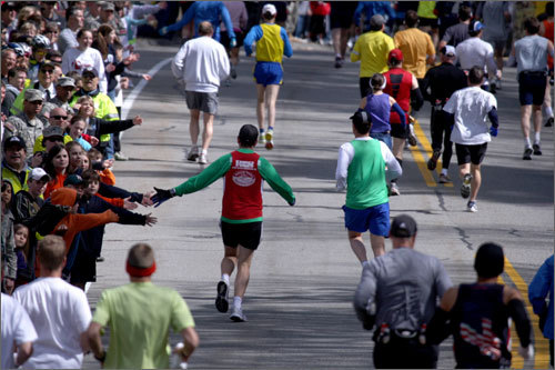 Always a traditional scene at the Boston Marathon: Onlookers wished runners best of luck just past the starting line in Hopkinton.