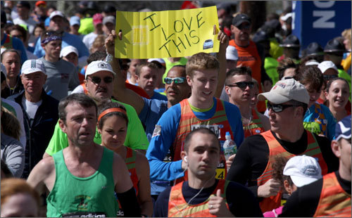 A runner held up a sign at the start of the marathon that read 'I love this.' We'll see if he's holding that sign at Heartbreak Hill.