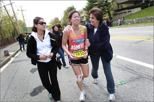 Runner Ashley Weinstein of Needham was running for Dana Farber and for her aunt Nancy Wolfson who died of ovarian cancer. Weinsten was injured and struggled in Newton, as her mother, Sherrie Weinstein comforted her. On left was her cousin Leah Potash.