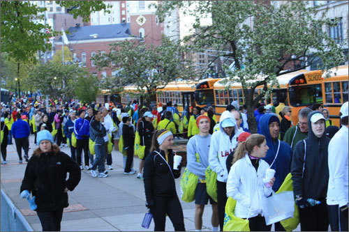 Boston Marathon runners formed lines as buses arrived at Boston Common to take participants to the starting line in Hopkinton.
