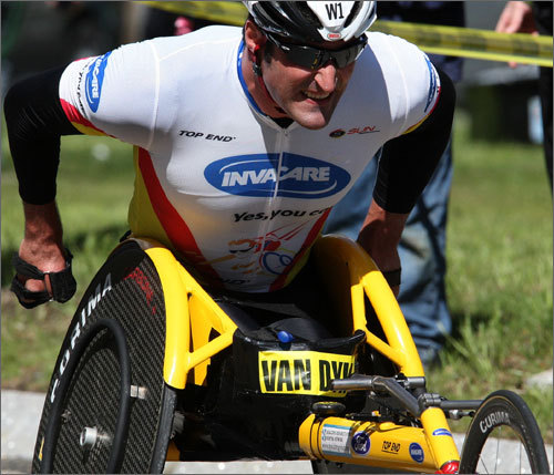 Wheelchair racer Ernst Van Dyk climbed up Heartbreak Hill. Van Dyk survived the challenging stretch and finished in first in the wheelchair race, his ninth career victory in Boston.