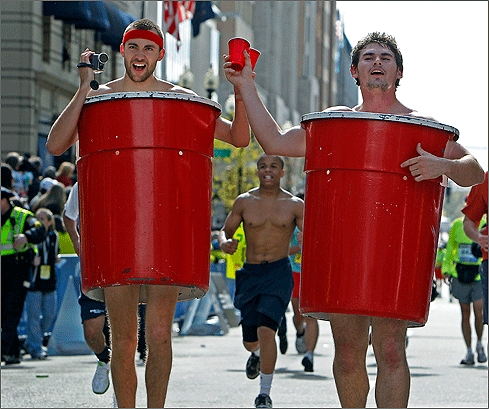 Two runners, dressed as red cups, toasted with red cups as they approached the finish line in Boston.