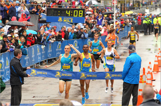 Andrew Baddeley, of Great Britain, edged out Markos Geneti, of Ethiopia to win the men's elite 1-mile race. Middle school aged boys and girls competed in a 1,000 meter race followed by a series of four one-mile races for professional men, professional women, high school boys, and high school girls on Sunday before the Boston Marathon.