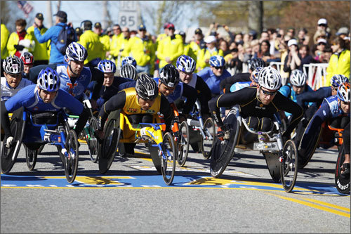 The competitors in the wheelchair race jockeyed for position right from the 9:17 a.m. start. They were the second group to hit the marathon course.