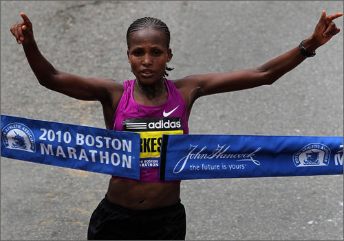 Teyba Erkesso of Ethiopia crossed the finish line on Boylston Street to win the women's race in the 114th Boston Marathon with a time of 2 hours 26 minutes 11 seconds. She held off Russia's hard-charging Tatyana Pushkareva to win by 3 seconds.