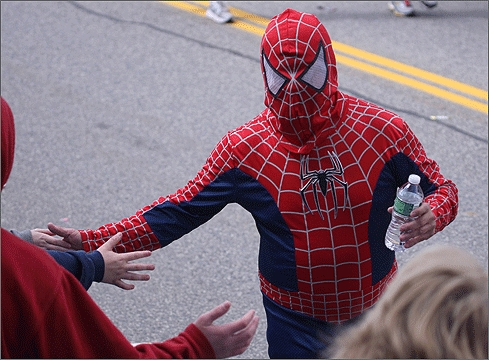 A person dressed as Spiderman shook hands after the start of the marathon.