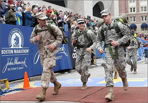 Members of the U.S. Military crossed the finish line. Though not costumed, these men were in uniform. The competitors are all thankful they didn't have to run the race while wearing backpacks.