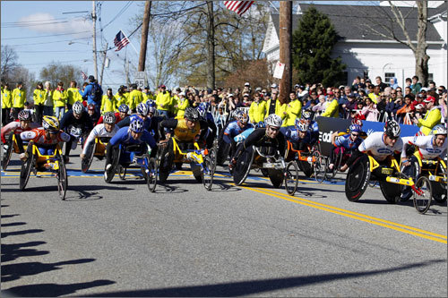 The wheelchair race began promptly at 9:17 a.m. They were the second group to hit the marathon course.