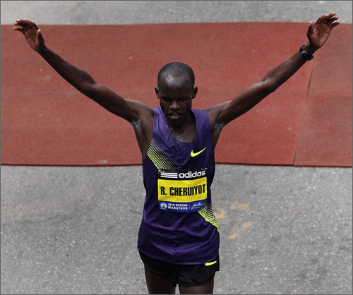 Kenya's Robert Cheruiyot raises his hands in triumph as he approaches the finish line. He won for the first time at Boston with an unofficial time of 2 hours 5 minutes 52 seconds, breaking the record of four-time winner Robert Kipkoech Cheruiyot.