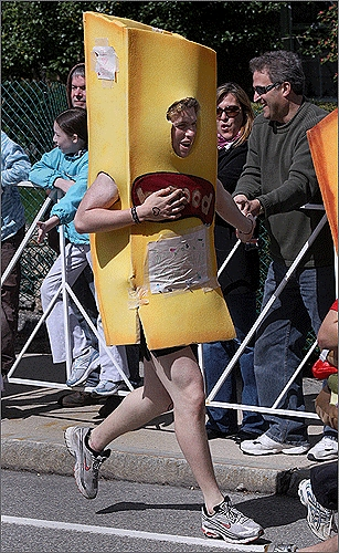 A person in a french fry suit tried to catch up to other runners.