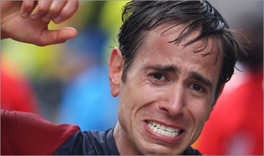 Michael Arnstein of New York shows the pain on his face after crossing the finish line.