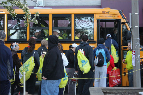 There were no assigned seats on the bus and lines formed for buses based on bib number.