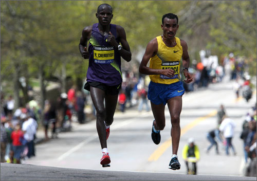Robert Cheruiyot (left) and Deriba Merga (right) led the elite men over Heartbreak Hill. There was no heartbreak for Cheruiyot in the race -- he won with a new course record of 2 hours 5 minutes 52 seconds.