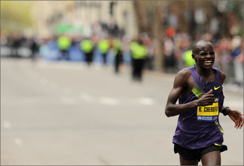 The pain was evident on men's winner Robert Cheruiyot's face as he ran almost the entire final two miles with no challenger in sight.