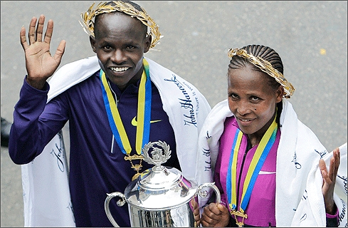 Cheruiyot (left) and and women's winner Teyba Erkesso of Ethiopia posed together near the finish line after the race.