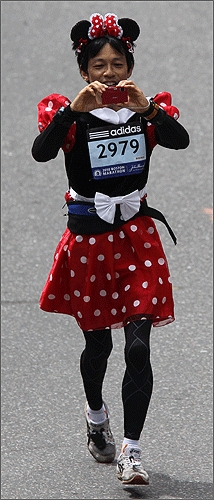 Tetsutomo Iizuka of Tokyo took on the look of Minnie Mouse as he raced.