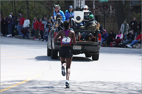 The eventual winner, Robert Cheruiyot, at Center and Beacon streets in Newton. (Photo by Barry M. Fisch of Newton)