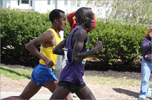 Robert Cheruiyot and Deriba Merga near Center and Beacon streets in Newton. (Photo by Barry M. Fisch of Newton)