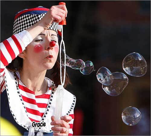 Nancy Quintin, known as 'Gracie the Clown' with the Big Apple Circus, entertained the crowd during the Boston Marathon pre-race dinner.