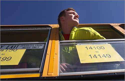 David Truxal, a transportation volunteer for the BAA, watches the scene at the start of the marathon.