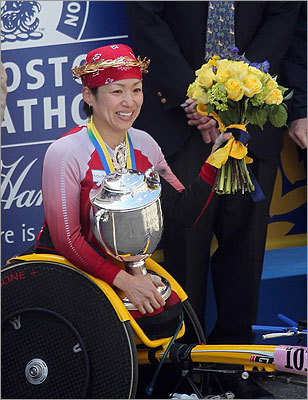 Tsuchida held up her trophy after winning the division.