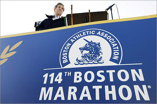 Senator John Kerry fired the ceremonial starter's pistol for the wheelchair race.