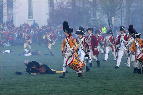 In this photo, the British walked past a field of wounded and dead Minutemen during the reenactment.