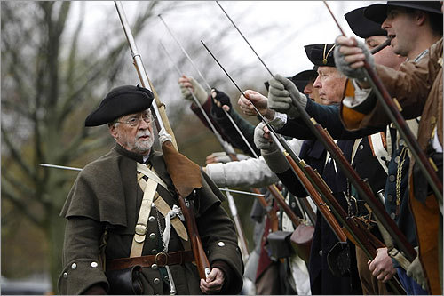 """To be part of the reenactment and find out that my great-great-great-great-great-great grandfather was there and played a role was certainly exhilarating,'' Poole said last week, counting with the fingers of his right hand as he ticked off the 'greats'. ""It was a tremendous surprise.'' In this photo, Poole inspected the Minutemen."