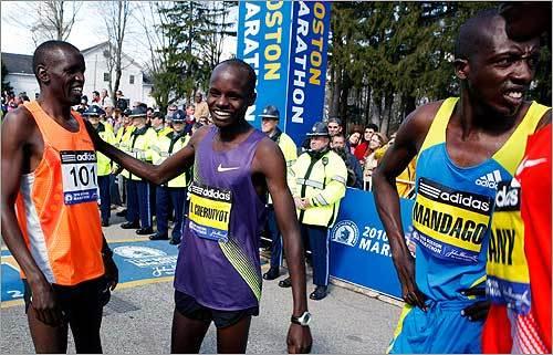 Kenyan runners, from left, James Koskei, Robert Cheruiyot, and David Mandago, wait for the start of the 114th running of the Boston Marathon.