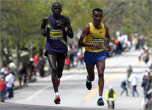 Robert Cheruiyot (left) and Deriba Merga were neck-and-neck near Heartbreak Hill in Newton. Cheruiyot eventually pulled away, and by setting a new course record, he earned a $25,000 bonus.