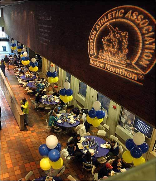 In the hallway where you pay your Boston parking tickets, runners enjoyed pasta during the Boston Marathon pre-race dinner at City Hall Sunday.