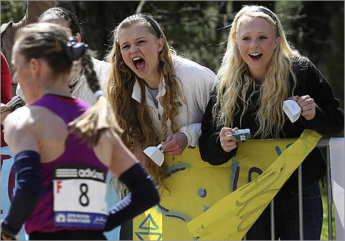 Senior Lauren Strand, left, and her sister Holly of Hampstead, cheered their hearts out as the Elite Women's runners strided by.