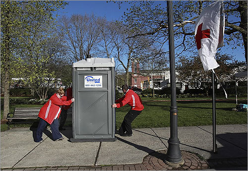 Red Cross volunteers Kim Binsfield and Bill Wormwald get the port-o-potties into position on Washington Street before the race.