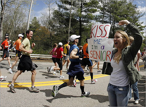 Wellesley College student Lauren Dow held a poster that read: 'Kiss me, I'm a senior.'