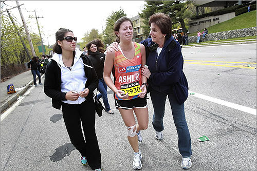 Runner Ashley Weinstein of Needhams ran in memory of Dana Farber and her aunt Nancy Wolfson, who died of ovarian cancer. Weinstein was injured and struggling in Newton, as her mother, Sherrie Weinstein of Needham, comforted her. On left is her cousin Leah Potash.
